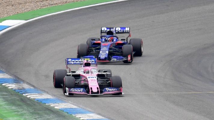 Lance Stroll, Racing Point RP19 and Daniil Kvyat, Toro Rosso STR14